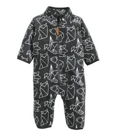 Dark gray. Jumpsuit in soft fleece with a printed pattern. Stand-up collar, zip at front, and elastic trim at cuffs and hems.