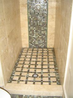 Mosaic waterfall of tile, spa bathroom, Strong linear lines created with custom cut elongated travertine tiles run from floor to ceiling par...
