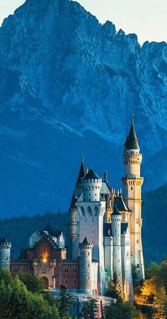 Neuschwanstein Castle, Above the village of Hohenschwangau, Bavaria, Germany.... http://www.castlesandmanorhouses.com/photos.htm ... Neuschwanstein Castle (Schloss Neuschwanstein), is a nineteenth-century Romanesque Revival palace. It was commissioned by King Ludwig II of Bavaria as a retreat and as an homage to Richard Wagner. The palace has appeared prominently in several movies and was the main inspiration for Disney's Sleeping Beauty Castle.