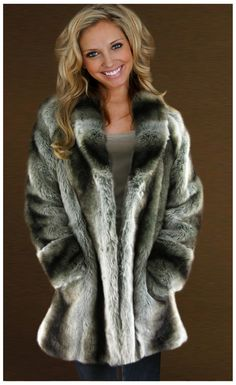 Chinchilla - 31 inch Faux Fur Coat  Our exclusive Chinchilla has subtle pelt lines with beautiful smoky black and brown and grey hues. Has the authentic look of real fur you will enjoy for many years.