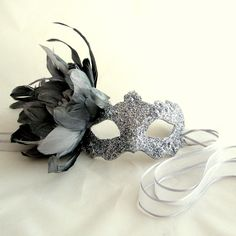 Luxury Silver Feather Supernova Venetian Masquerade Masked Ball Mask. $79.99, via Etsy.