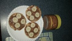 My favorite snack! Caramel rice cakes, almond butter, topped with bananas! Low in carbs, high in protein and gluten free!