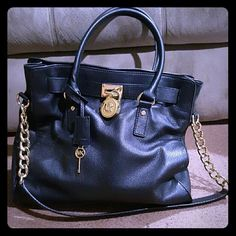 Michael Kors Hamilton Authentic Michael Kors black leather Hamilton with gold metal details. Gently used, dearly loved, but looking to switch up my MK collection. The lock has 6 small scratches (hard to see) but it is a great bag, in great condition.  No Trades. Michael Kors Bags Satchels
