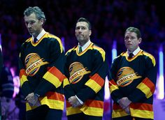 Former Vancouver Canucks Trevor Linden Kirk McLean and Pavel Bure listen to the national anthem during their NHL game against the Philadelphia Flyers. Nhl Games, Hockey Games, Hockey Players, Ice Hockey, Hockey World, Vancouver Canucks, Philadelphia Flyers, Detroit Red Wings, National Anthem