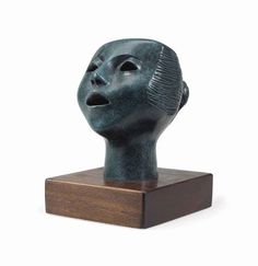 Elizabeth Catlett (1915-2012)  'Singing Head'  inscribed with initials 'EC' (on the back of the neck)  bronze with bluish-green patina  7 in. (17.8 cm.) high on a 1¾ in. (4.5 cm.) wood base  Modeled in 1968.