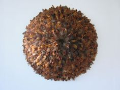 Decoy 2012 Susie MacMurray   convex wall sculpture  pheasant 'goldside' feathers  100cm diameter