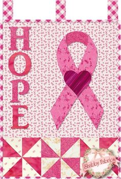 "Little Blessings - Pink Ribbon Pattern: Show your encouragement of those affected by breast cancer with this special wallhanging design by Jennifer Bosworth of Shabby Fabrics. This pattern is for the Pink Ribbon design. Wallhanging measures 12"" x 18"" and hangs from a darling dowel hanger (not included - available separately below - separate $4 US/$6 International shipping charge applies). The purchase of this pattern supports breast cancer research."