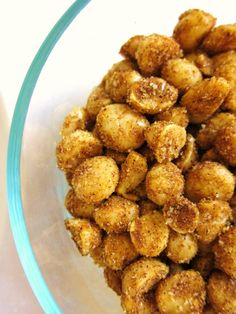 Spiced Macadamia Nuts 1 Tbsp oil 2 cups macadamia nuts OMIT SUGAR 1 tsp curry powder 1 tsp ground cumin 1 tsp ground coriander 1 tsp chili powder 1 tsp kosher salt 1/2 tsp cayenne pepper Preheat oven to 250, toss, bake, 25 to 30 minutes.