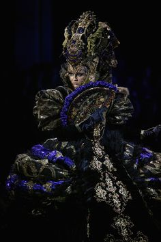 A model showcases designs on the catwalk during MGPIN Make-up Styling 2012 of China Fashion Week Spring/Summer 2012 on November 1, 2011 in Beijing, China.