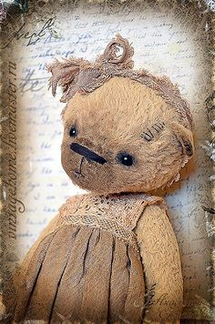 a distressed bear....but absolutely delightful. (i love her vintage dress!)