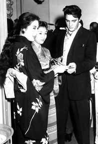 Elvis Presley and actors Takamine Hideko and Shira Kawayumi