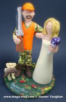 video of Hunting Wedding Cake Toppers ...it's open season on these made to order wedding cake toppers!!...perfect for brides and grooms that like hunting, .. :-) ... want them in gown and suit or camo outfits??..., or any combination of....   http://blog.magicmud.com 1 800 231 9814   $235 #hunting#hunter #camouflage#sportsman#wedding #cake #toppers  #custom #personalized #Groom #bride #anniversary #birthday#wedding_cake_toppers#cake_toppers#figurine#gift