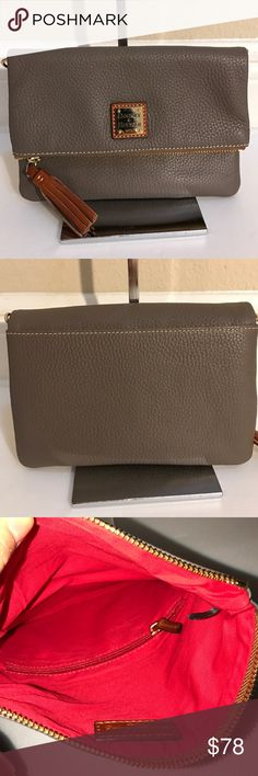 """Dooney&Bourke Pebble Leather FoldoverZip Crossbody In excellent condition. (Does not come with strap) color elephant . Measures approximately 8-1/2""""W x 6""""H x 1""""D ; weighs approximately 8 oz Body/trim 100% leather; lining 100% cotton Dooney & Bourke Bags Crossbody Bags"""