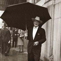 John Wayne Standing Under a Big Black Umbrella in the Rain in London ...
