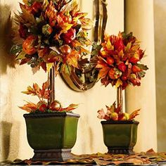 Use three graduated sizes of pumpkins for a larger fall decoration, or do two urns for 2 stunning fall front door arrangements.