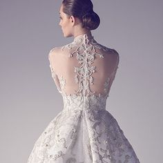 Ashi Studio's Spring 2015 couture collection unfolds like a dream. Graceful, striking forms mesmerize in various shades of white. Sculpted flounces meet