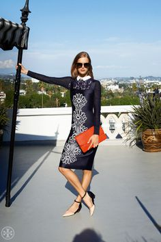 Add a clutch in a fiery shade to heat up a cool navy-and-white palette | Tory Burch Resort 2014