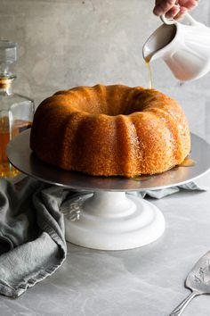 This vegan rum cake is incredibly moist, rich, and soaked in a buttery rum sauce. This simple yet indulgent pound cake is the perfect dessert for any occasion from a weeknight dinner to a showstopper dessert during the holidays. Vegan Sweets, Vegan Desserts, Healthier Desserts, Rum Cake From Scratch, Vegan Foods, Vegan Meals, Healthy Foods, Vegetarian Recipes, Vegan Recipes