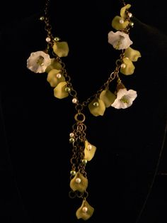 Lucite Flower necklace with green lucite leaves by Doreendidit, $50.00