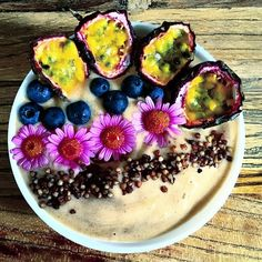 Good morning everyone I hope you all had a good weekend & ready for a great week!! Today's breakfast is a light nicecream smoothie with a frozen banana some chia pudding  vanilla extract baobab homemade almond milk maca & a touch of stevia. I  made the chia pudding with the almond milk the usual way ( 1/4tbsp chia 1c milk overnight) & blended some with the rest of the ingredients . I topped it with passion fruit blueberries & homemade cacao buckwheat granola. The pink flowers are there as a…