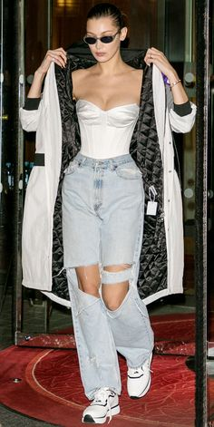 Look of the Day Keeping things extra trendy, Bella Hadid hit the streets of Paris in a white corset tucked into ripped jeans. A black-and-white coat and matching sneakers completed her fashion-forward look. Bella Hadid Outfits, Bella Hadid Style, Bella Gigi Hadid, Trendy Outfits, Summer Outfits, Fashion Outfits, Fashion Trends, Sneakers Fashion, Fall Outfits