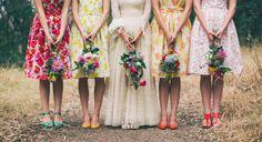 mismatched bridesmaid dresses in floral prints