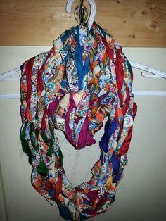 Arm knitted sari silk ribbon yarn paired with Organza fabric yarn
