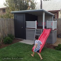 This is a garden shed with cubby house on the side, complete with chalkboard, hardwood, deck, wave slide and additional underneath storage area.
