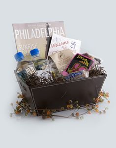 Welcome your guests to the city of brotherly love with some local snacks full of Philly flavor! Kate Parker Designs has great baskets for 18 different cities from $30-$50.