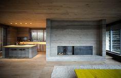 modern kitchen & livingroom in a former barn in soglio, switzerland by armando ruinelli #fireplace