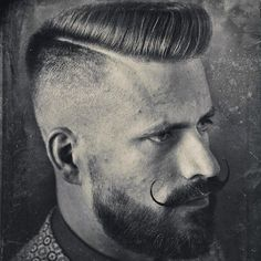Handlebar Mustache with Thick Beard and Fade