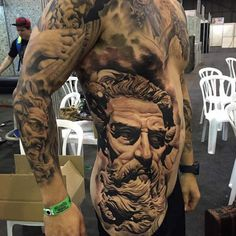 Cool Rib Tattoos for Girls and Guys Rib Cage Tattoo Hi Here we have great photo about body tattoo ribs. Girl Rib Tattoos, Rib Tattoos For Guys, Cage Tattoos, God Tattoos, Tatoos, Zeus Tattoo, Tiger Tattoo, Chest Tattoo Text, Cool Chest Tattoos