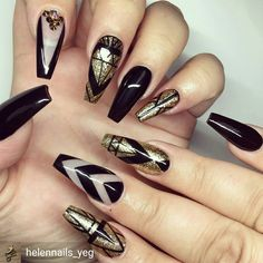 Beautifully done black and gold nails