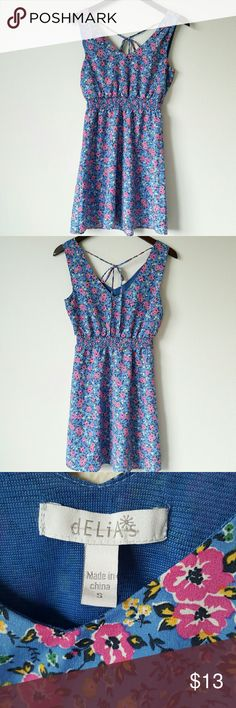 Blue floral summer dress Blue summer dress witg pink and yellow flower floral pattern. Has small pleated sleeves, fitted elastic waist, and a tie in the back for a strappy, lace up look!  Brand is Delia's. Size S, small. No flaws! Delia's Dresses Mini