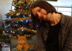 James and Bob celebrating a successful Christmas charity drive :-) - from FB page James Bowen & Streetcat Bob
