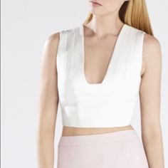 """BCBG Max Azria """"Rina"""" crop top V-neckline. Sleeveless. Cropped silhouette. Center back zipper with hook-and-eye closure. Self: Polyester, Rayon, Spandex double weave. Lining: Cotton, Nylon, Spandex poplin. Machine Wash. BCBGMaxAzria Tops Crop Tops"""
