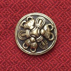 Modern recreation of a 10th century Viking round brooch, found in Birka, Uppland, Sweden.  Used by women to fasten the neck of the linen underdress, from a wealthy female burial.