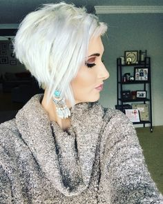 Platinum pixie hair cut ice white pixie hair long pixie blonde pixie smokey eye