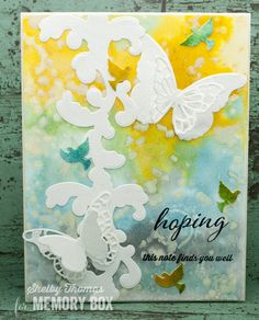 Good morning everyone. Shelby with you today to bring hopefully just a little cheer to your day. I pulled out my distress inks (again) to create the background. The colors used were Wild Honey, Tumbled Glass and Hickory Smoke. The texture was added with a stencil and distress paint (antique linen) applied through the stencil. The birds (trio of doves) was cut from watercolor paper using the same colors, but I used the refills instead of the pad which with the same amount of water creates a…