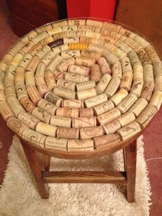 Wine cork stool. thinking of using my small side table that needs a better looking top.