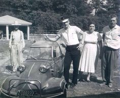 """Elvis with parents and former Tupelo neighbor, Dan Shacklefordand on May 1956 in the backyard of his 1034 Audubon Drive home in Memphis,TN, with his three-wheeled Messerschmitt """"bubble car"""". Photo by Phillip Harrington for LOOK magazine. Elvis Presley Pictures, Elvis Presley Family, Lisa Marie Presley, Priscilla Presley, Rock And Roll, Graceland, Vernon, Mom And Dad, Dads"""
