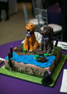 A pretty amazing groom's cake by Amy Cakes. Photo by Heather Ann Design & Photography. #wedding #cake #dog #hunting #tcu