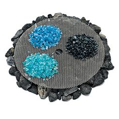 Use colored glass to get your fire pit glowing: Put lava rock on the embers, then a mesh screen, and top with colorful fire glass from The Custom Fire Place (thecustomfireplace.com) for a glittery flame with some extra special sparkle.
