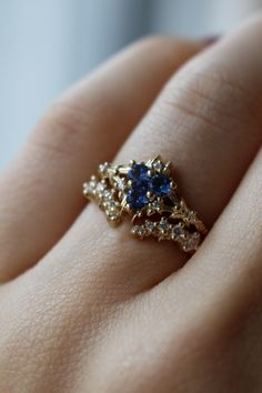 "This bridal ring stack was inspired by the Zora's Sapphire from the Legend of Zelda: Ocarina of Time. After she has been rescued, Princess Ruto gives the Zora's Sapphire to Link and says ""My Mother gave it to me and said I should give it only to the man who will be my husband. You might call it the Zora's Engagement Ring!"""