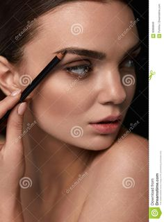 Beautiful Woman Contouring Eyebrows. Glamorous Makeup Stock