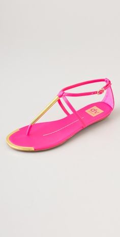 Fun, bright sandals in hot pink.  Gold details around the toe line make these unique.  Also available in green and nude.