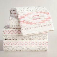 One of my favorite discoveries at WorldMarket.com: Coral and Taupe Tula Sculpted Towel Collection