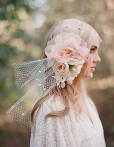 Why not add s floral arrangement to your veil or fascinator for something different? Weddingtender.com