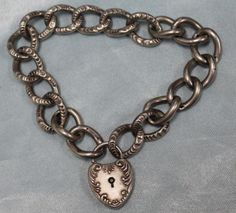 Vintage-Sterling-Silver-Charm-Bracelet-with-Sterling-Silver-Heart-Locket