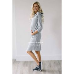 """Running errands never looked so cute! This casual dress is comfy, soft and totally cute! Heather gray dress features a hoodie and front pocket.Total Length: XS-S: 39""""M-L: 39.5""""XL: 40""""63% Modal 37% PolyesterAmanda is a size 0/2, 5'8"""" and is wearing the XSSpecificationsAlphaXXSXSSMLXLXXL Numeric000 - 24 - 68 - 1012 - 141618 - 20  Bust30½ - 31½32 - 3333½ - 3536 - 3840 - 4243½ - 44½46 - 47 Waist23 - 2424½ - 25½26 - 27½28½ - 30½32½ - 34½36 - 3738½ - 39½ High Hip30 - 31..."""